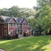 Long Island North Shore Colonial on Private Wooded Acre